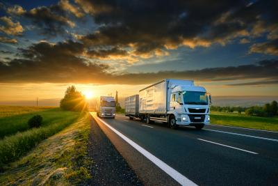 Overtaking trucks on an asphalt road