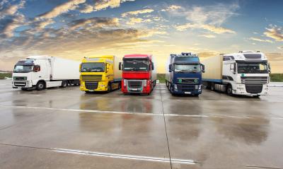 Five trucks at sunset
